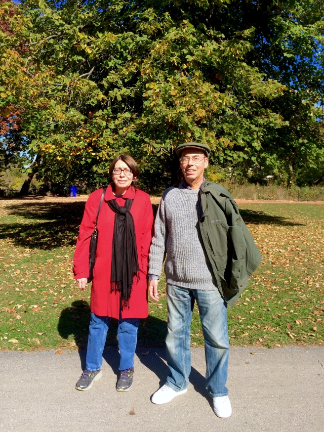 Red Jacket Lady and Guy with Cool Hat